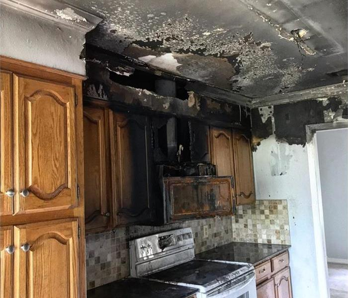 This is an image of a post fire kitchen area where a microwave caught on fire.