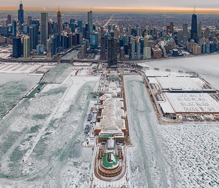 This is a helicopter view of the city landscape, above Navy Pier, during the 2019 Polar Vortex.