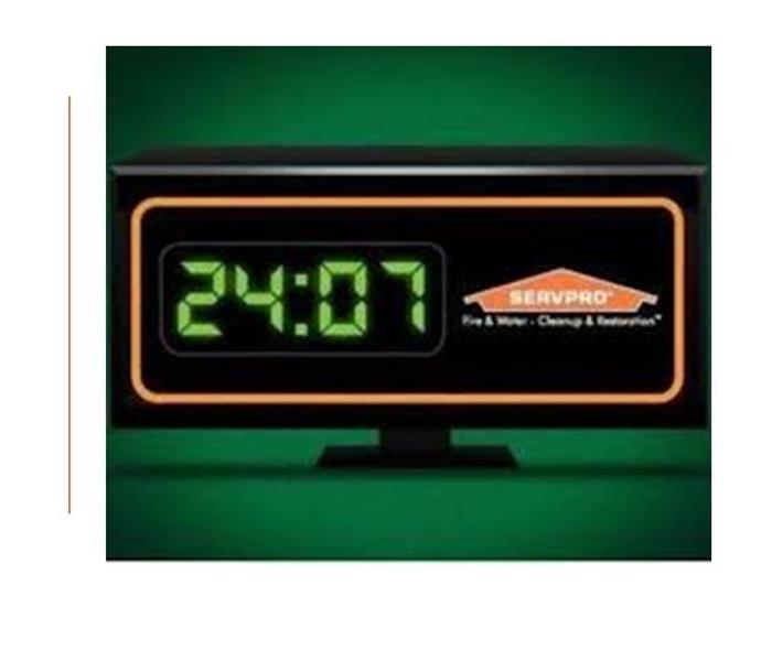 Image of a digital clock the shows the time as 24:07
