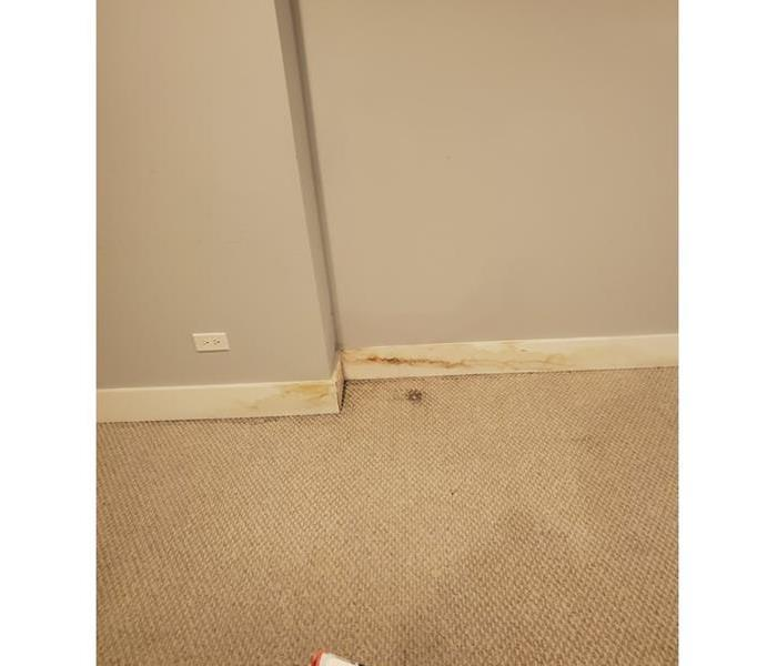 A water stain will appear on the surface of the wall or baseboard opposite of the affected area.